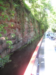 Steep rock formations on the side of the canal